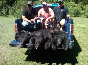 (L-R) Caleb Giddens, Allyn Stockton and Richard Davis. Allyn's bear in the center weighed 500-pounds and was among the largest checked in.