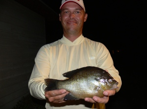 Michael Deen of Waycross displays the latest in a parade of Angler Award-sized redbreasts.