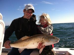 Brianna Bennett (right) caught and released this bull redfish while fishing with Capt. TJ Cheek on a nearshore reef. This was Brianna's first redfish and her biggest fish ever!
