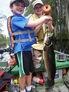 Nathanael Johnson (left) of Blackshear caught this 10-lb., 6-oz. monster bowfin (mudfish) while fishing with his cousin Timothy Deener of Waycross on Saturday.