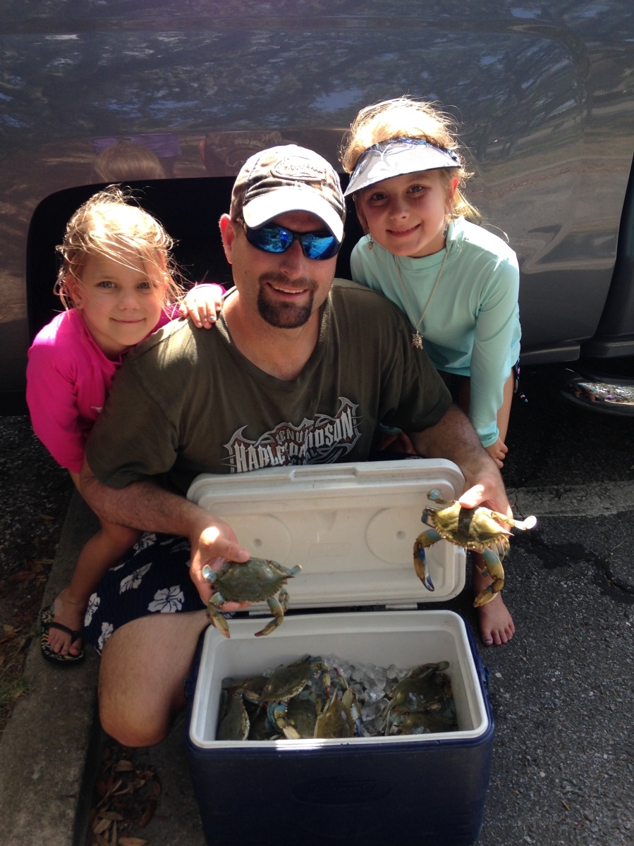 Crabbing is a fun family pursuit for the holiday weekend. The Bonvechio family (left to right: Lily, Tim, Hannah and Kim – the photographer) loves catching crabs with hand-lines on the Georgia coast.